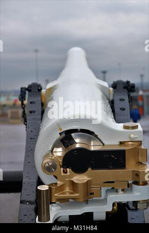 White and gold metal field cannon at Portsmouth Historic Dockyard, UK - Stock Photo