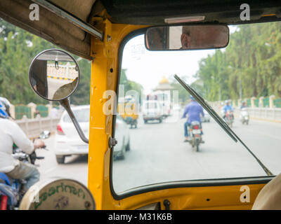 View from inside of a auto rickshaw in India. Also known as tuk tuk. - Stock Photo