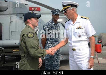 SINGAPORE (June 3, 2013) Naval Aircrewman Tactical 2nd Class Jordan Neiman, assigned to Helicopter Maritime Strike - Stock Photo