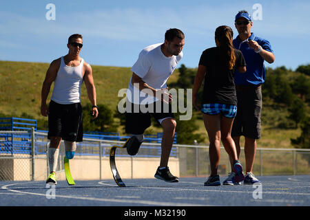 Nicholas Dadgostar, Wounded Warrior athlete, runs a sprint drill during  track and filed practice Aug. 3, 2014 at - Stock Photo