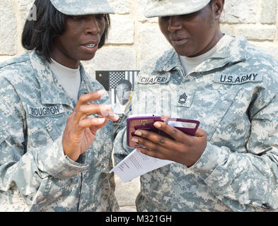 CLAY NATIONAL GUARD CENTER, Marietta, Georgia, August 7, 2014 – Remembering the good times, Sgt. 1st Class Cynthia - Stock Photo