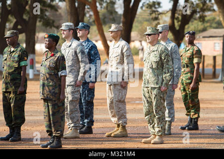 Military personnel and delegates from more than 40 nations gather at the Zambian Army Headquarters, Aug. 7, 2013, - Stock Photo