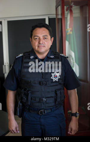 Local police chief Darwin Puc Acosta poses for a photo at police headquarters in downtown Cancun, Mexico, on July - Stock Photo