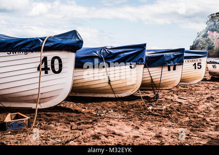 Rowing boats moored on the beach at Shaldon.  April 2016 - Stock Photo