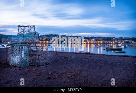 Fishermen lobster pots left out to dry on the beach at Shaldon, Devon. - Stock Photo