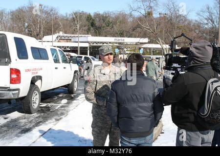 WEST LAKE MARTA STATION, Atlanta, Ga., Jan. 30, 2014  – Georgia Army National Guardsman 1st Lt. Bart Scocco, the - Stock Photo
