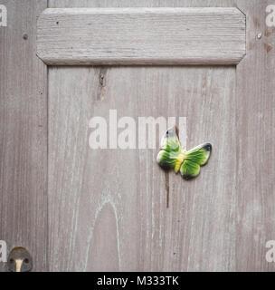 Close up shot of cupboard wooden door - Stock Photo
