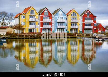 Multi-colored houses along the waterfront, Greifswald, Vorpommern-Greifswald, Mecklenburg-Vorpommern, Germany - Stock Photo