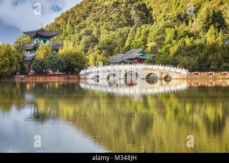 Suocui Bridge in the Jade Spring Park in Lijiang, China. - Stock Photo