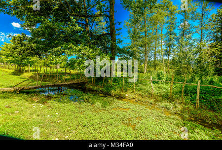 Old wooden bridge over a small river in a Georgian village, - Stock Photo