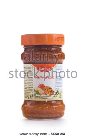 Glass Jar of Spanish tomato pesto, isolated on white, with copy space - Stock Photo