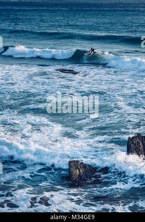 Surf activity at the beach of Masua near the Pan di Zucchero at the west coast of Sardinia. Italy. - Stock Photo