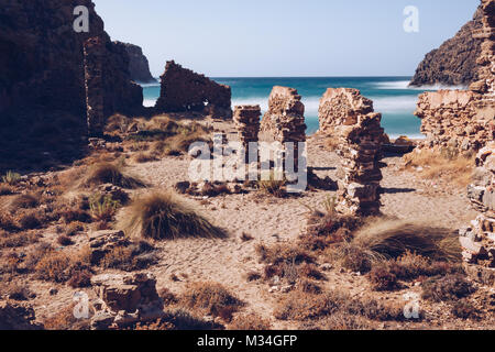 Long exposure of the beach of (Cala Domestica) with acient ruin  at the west coast of Sardinia. Italy. - Stock Photo