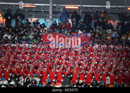 PyeongChang, South Korea. 9th Feb, 2018. Performers from North Korea cheer and wave flags during the Opening Ceremony - Stock Photo
