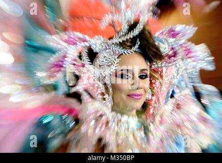 Canary Islands, Spain. 9th Feb, 2018. One of the candidates to be elected Queen of the Carnival 2018 smiles prior - Stock Photo