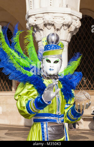 Venice, Veneto, Italy, 9th February 2018. Colorful costumes and masks during todays festivities despite the ongoing - Stock Photo