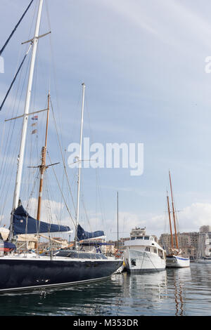 Sailboats and a houseboat in the Old Port or Vieux Port in Marseille France. Buildings are in the background and - Stock Photo