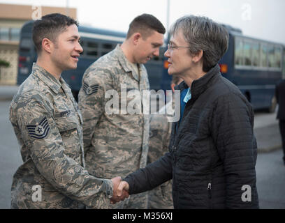 Secretary of the Air Force Heather Wilson coins U.S. Air Force Tech. Sgt. Landen Sifferlin, 18th Wing protocol NCO - Stock Photo