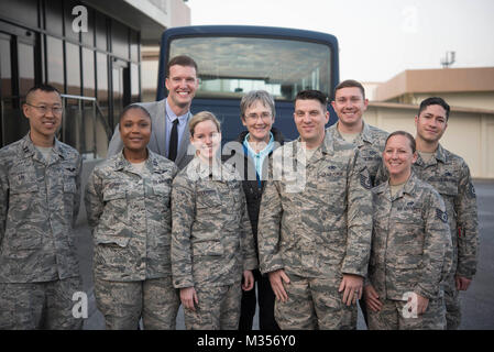 Secretary of the Air Force Heather Wilson stands with members of the 18th Wing protocol office near the end of her - Stock Photo