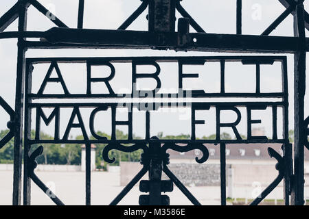 DACHAU, GERMANY - July 6, 2016 ; The Main gate of concentration camp with the sign ARBEIT MACHT FREI - Holocaust - Stock Photo