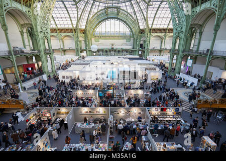 PARIS - NOVEMBER 10: Paris Photo art fair high angle view with people at Grand Palais on November 10, 2017 in Paris, - Stock Photo
