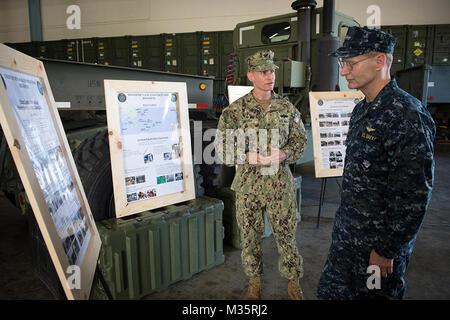 Capt. James G. Meyer, Commodore, 30th Naval Construction Regiment (NCR), briefs Vice Adm. Joseph P. Aucoin, Commander, - Stock Photo