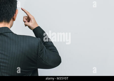 Asian business man finger at head for use his brain to thinks clever intelligent - Stock Photo