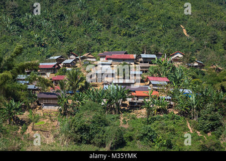 Traditional lao village landscape seen from the Mekong river in Laos - Stock Photo