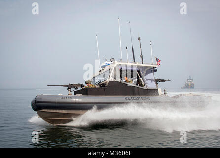 U.S. Coast Guardsmen, assigned to Port Security Unit 309 in Port Clinton, Ohio, conduct security patrols during - Stock Photo