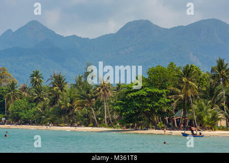 Koh Chang, Thailand - March 12, 2017: Tourists rest on the beautiful tropical beach on Koh Chang island in Thailand - Stock Photo