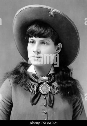 ANNIE OAKLEY (1860-1926) American exhibition sharpshooter