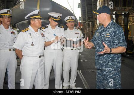 161128-N-MW990-015 CHANGI NAVAL BASE, Singapore (November 28, 2016) USS Coronado (LCS 4) Commanding Officer Cmdr. - Stock Photo