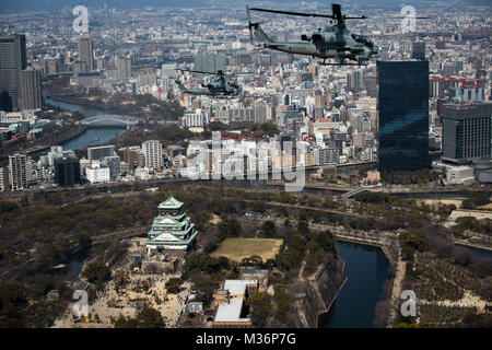 AH-1Z Vipers soar through the skies over Osaka Castle, Osaka, Japan, March 12, 2017. Marine Light Attack Helicopter - Stock Photo