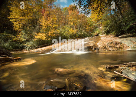 Sliding Rock Waterfall in the Appalachian mountains of western North Carolina in great fall colors - Stock Photo