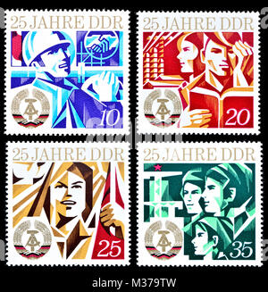 East German postage stamps (1974) : 25 Years of the DDR / German Democratic Republic. - Stock Photo