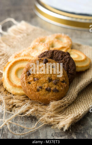 Assorted butter cookies on wooden table - Stock Photo