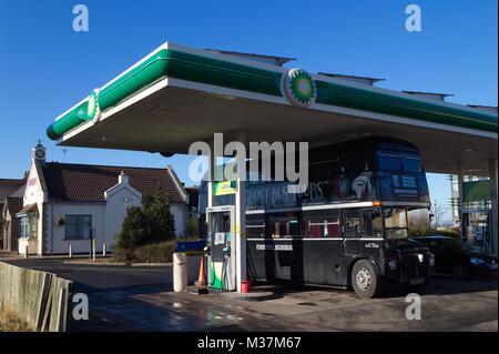 Edinburgh, Scotland / United Kingdom - February 09 2018: A photograph of the Edinburgh Ghost Bus Tour refuelling - Stock Photo