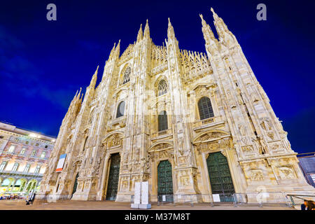View of the Milan Cathedral at night in Milan, Italy. - Stock Photo
