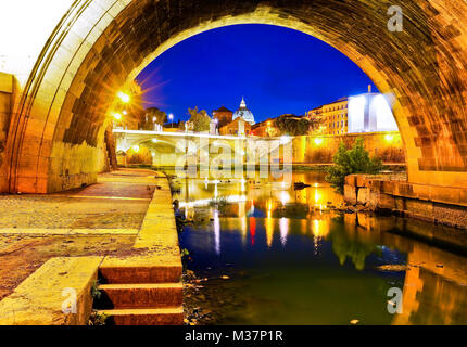 View of St. Peter's Basilica from Aelian Bridge in Rome at night. - Stock Photo