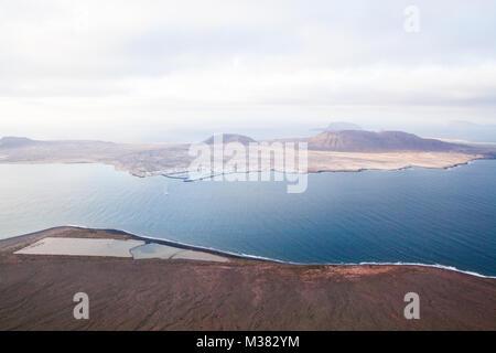 Mirador del Río, Lanzarote, Spain: View from the Mirador del Río towards the island of La Graciosa, Salinas del - Stock Photo