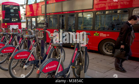 'Boris Bikes,' with Santander branding, are locked in their racks outside the victoria and Albert Museum, in London, - Stock Photo