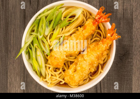 Japanese Style Tiger Prawn Tempura Noodle Soup With Spring Onions On A Dark Wooden Kitchen Table - Stock Photo