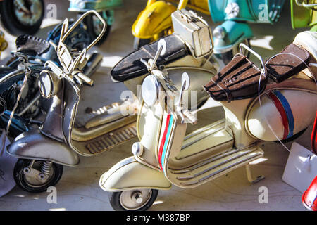 miniatures of iconic  italian scooter also known as vespa - Stock Photo