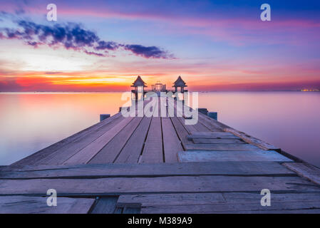 Landscape of Wooded bridge in the port between sunset - Stock Photo