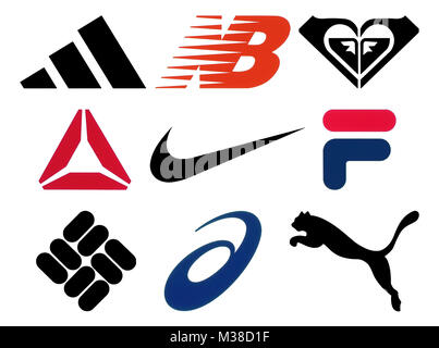 Kiev, Ukraine - October 27, 2017: Set of popular sportswear manufactures logos printed on paper: Adidas, New Balance, - Stock Photo