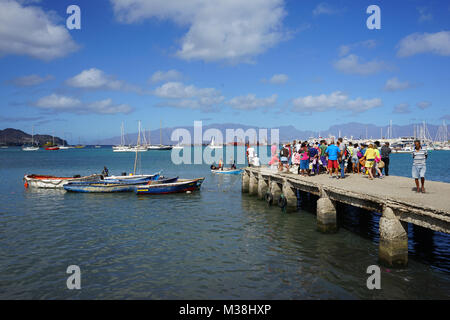 People watching Fishermen, bringing Fish to the Fish Market in Mindelo - Stock Photo