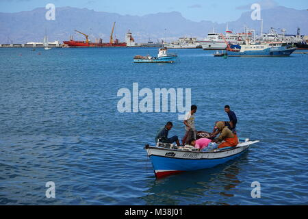 fishermen bringing fish to the fish market in Minelo - Stock Photo