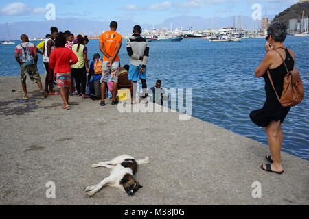 People Watching the Unloading of Fisher Boats in Mindelo, sao Vincente, Cape verde - Stock Photo