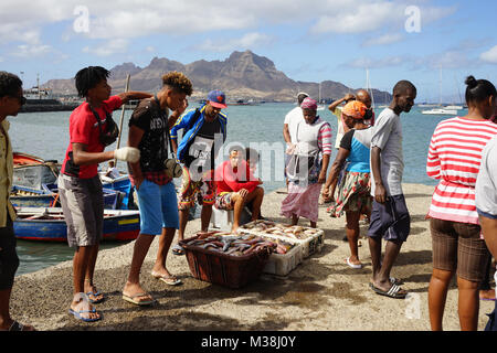 People on the landing Stage of the fish market in Mindelo, watching the unloading of fishes - Stock Photo