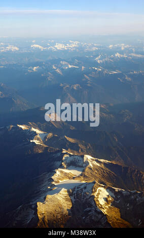 Rocky Mountains aerial view with sunrise - Stock Photo